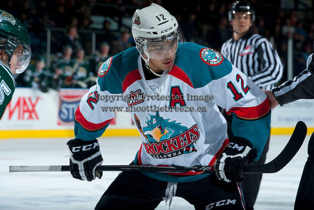 KELOWNA, CANADA - JANUARY 22: Tyrell Goulbourne #12 of the Kelowna Rockets faces off against the Everett Silvertips on January 22, 2014 at Prospera Place in Kelowna, British Columbia, Canada.   (Photo by Marissa Baecker/Getty Images)  *** Local Caption *** Tyrell Goulbourne;