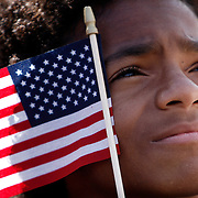 "TP_296210_ALLE_Obama_01.WILLIE J. ALLEN JR.  |   Times.(10/20/2008).Future Barack Obama voter Jordan Tryman (cq) watches him during the ""early vote for change"" rally Monday at Legends Field Monday to promote the start of early voting in Florida(WILLIE J. ALLEN JR.   