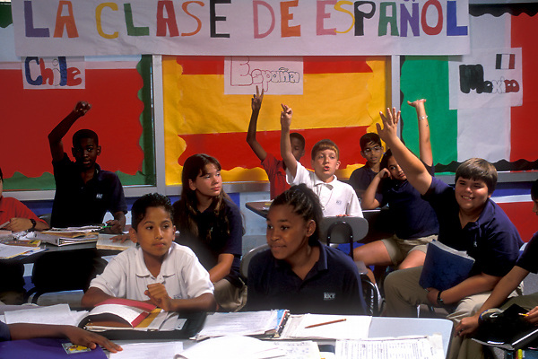 Stock photo of a group of young students learning Spanish in the classroom