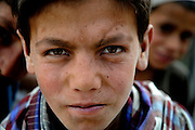 "An Afghan child stares with his best ""hundred yard stare"" Apr. 18, Afghanistan."