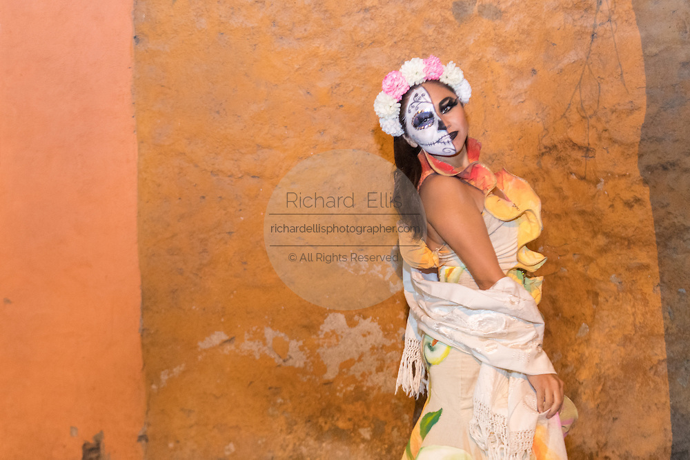 A woman dressed as La Calavera Catrina poses during the Day of the Dead festival November 1, 2016 in San Miguel de Allende, Guanajuato, Mexico. The week-long celebration is a time when Mexicans welcome the dead back to earth for a visit and celebrate life.
