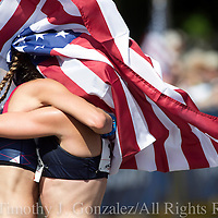 Maria Michta-Coffey, left, embraces Miranda Melville after she crosses the finishing in the womens Olympic Trials 20K race walk in Salem, Ore., on Thursday  June 30, 2016.