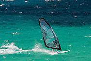 Windsurfing near Zlatni Rat beach. Bol, on the island of Brac, Croatia