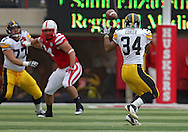 November 25, 2011: Iowa Hawkeyes running back Marcus Coker (34) pulls in a pass during the first half of the NCAA football game between the Iowa Hawkeyes and the Nebraska Cornhuskers at Memorial Stadium in Lincoln, Nebraska on Friday, November 25, 2011. Nebraska defeated Iowa 20-7.