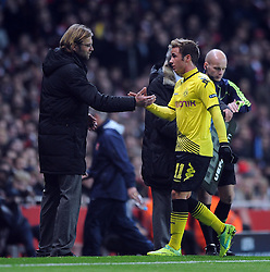 23.11.2011, Emirates Stadion, London, ENG, UEFA CL, Gruppe F, FC Arsenal (ENG) vs Borussia Dortmund (GER), im Bild Borussia Dortmund's Mario Gotze shakes hands with manager Jurgen Klopp as he leaves the field through injury during the football match of UEFA Champions league, group F, between FC Arsenal (ENG) and Borussia Dortmund (POR) at Emirates Stadium, London, United Kingdom on 2011/11/23. EXPA Pictures © 2011, PhotoCredit: EXPA/ Sportida/ Chris Brunskill..***** ATTENTION - OUT OF ENG, GBR, UK *****