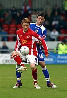 Photo: Dave Linney.<br />Crewe Alexander v Cardiff City. Coca Cola Championship. 17/04/2006.Cardiff's Joe Ledley(R)  trys to stop the progress of  Steve Jones