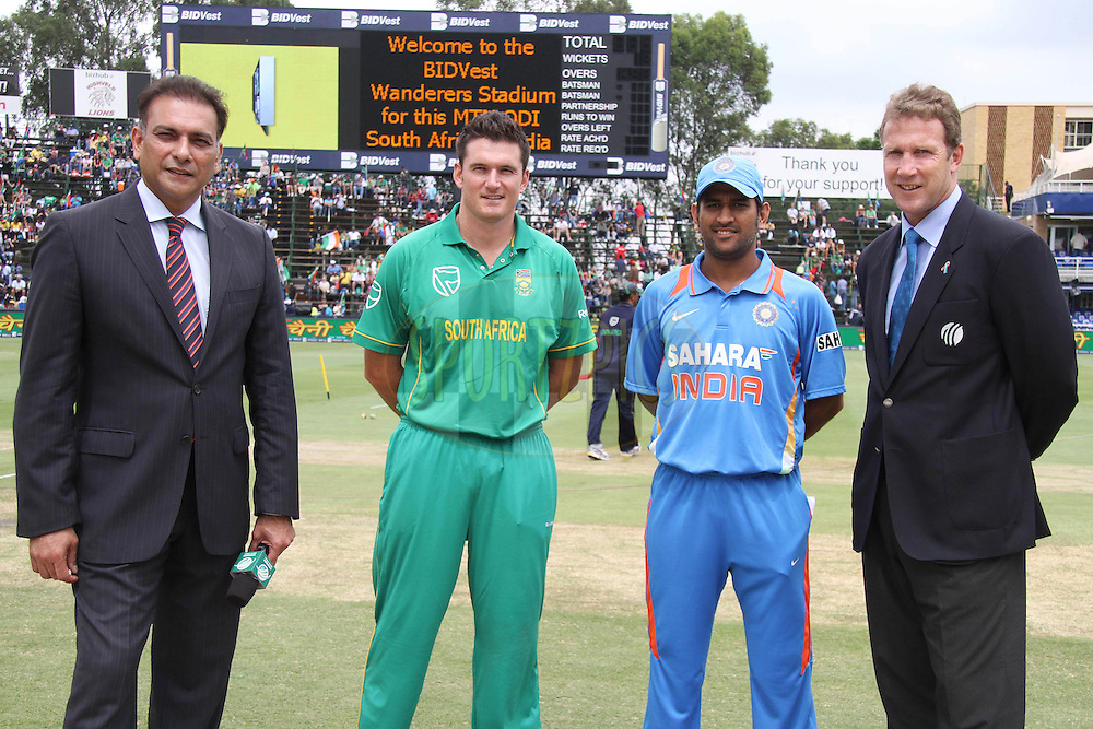 Commentator Ravi Shastri, South African captain Graeme Smith, Indian Captain Mahendra Singh Dhoni and match referee Chris Broad at the coin toss during the 2nd ODI between South Africa and India held at Wanderers Stadium in Johannesburg, South Africa on the 15th January 2011..Photo by Shaun Roy/BCCI/SPORTZPICS