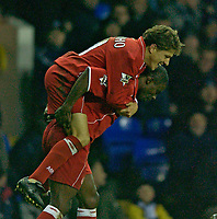 Photo. Jed Wee.<br /> Tottenham Hotspur v Middlesbrough, Carling Cup, White Hart Lane, London. 17/12/2003.<br /> Middlesbrough's Juninho jumps on the shoulders of team mate George Boateng after their late equaliser.