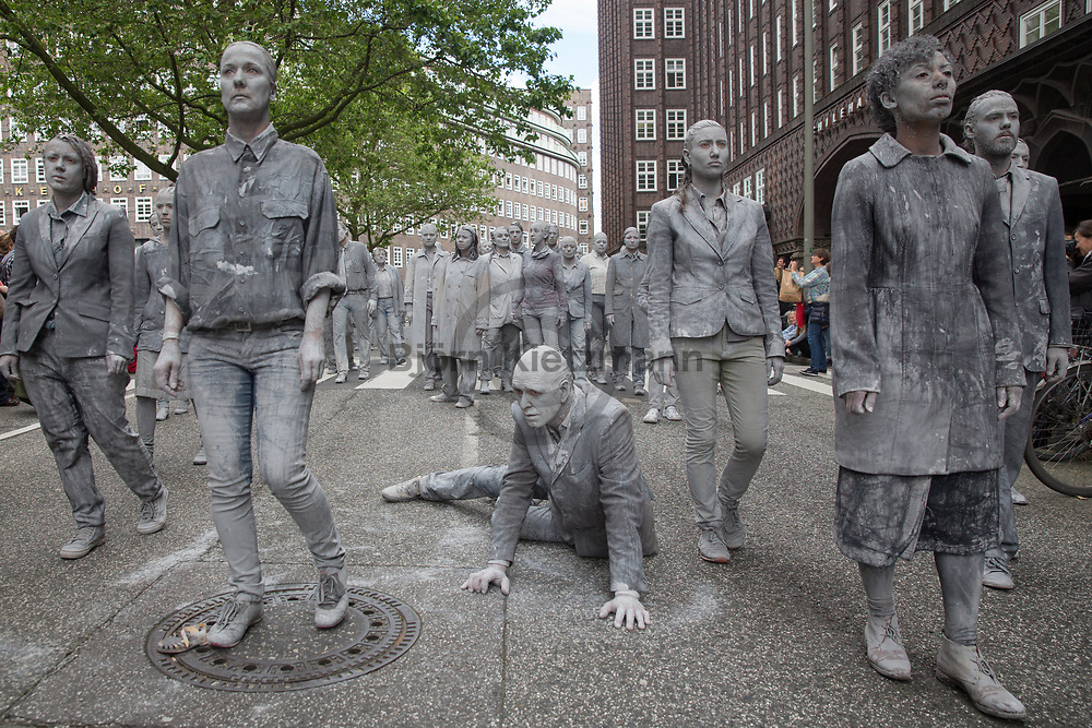 Hamburg, Germany - 05.07.2017<br /> <br /> Political anti-G20 art performance &quot;1000 Gestalten&rdquo; (&rdquo;1000 figures&rdquo;) move through Hamburg. With their action, the artists want to set a sign for more solidarity and political participation.<br /> <br /> Politische Anti-G20 Kunstperformance &rdquo;1000 Gestalten&rdquo; zieht durch Hamburg. Mit ihrer Aktion wollen die Kuenstler ein Zeichen fuer mehr Solidaritaet und politische Partizipation setzen.<br /> <br /> Photo: Bjoern Kietzmann
