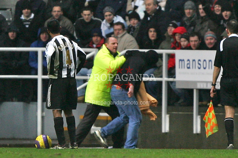 Newcastle, England - Saturday, February 10, 2007: A supporter is  caught as he invades the pitch during the Newcastle United and Liverpool  the Premiership match at St James' Park. (Pic by Dave Kendall/Propaganda)