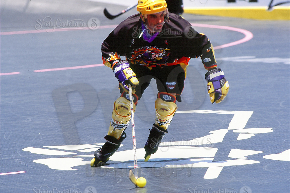 5 June 1999: Roller hockey player skating forward with yellow ball during Pro Beach Hockey PBH game in Huntington Beach.   Southern California summer sport. Transparency slide scan.  Brett Kurtz.  Team Express.