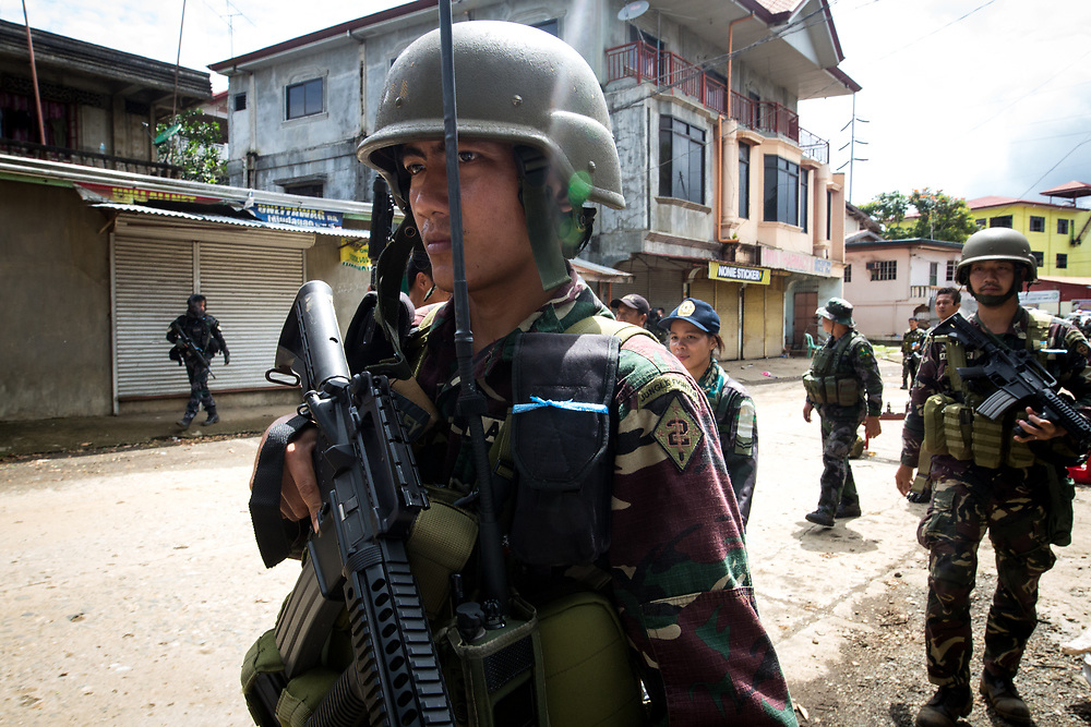 MARAWI, PHILIPPINES - JUNE 6: Government troops walk inside of a NO GO ZONE to search for explosives and firearms left be Islamic rebels in Marawi City in Southern Philippines, June 6, 2017. (Photo: Richard Atrero de Guzman/NUR Photo)