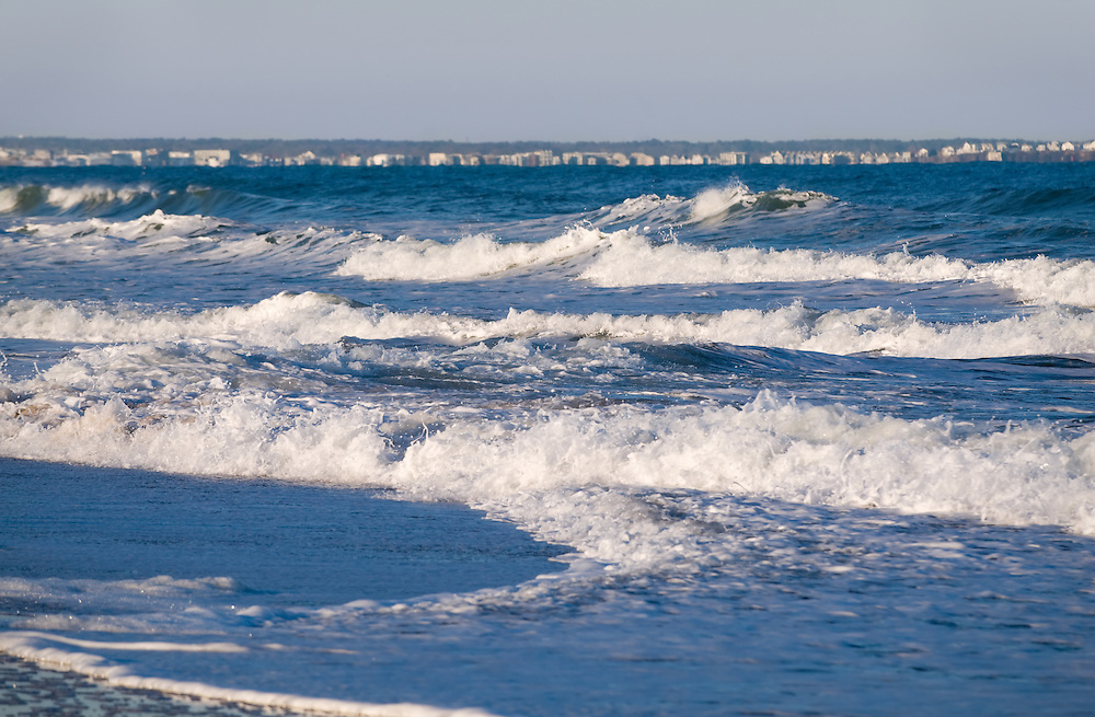 The ocean reflects hues of blues and violets on a late winter afternoon.