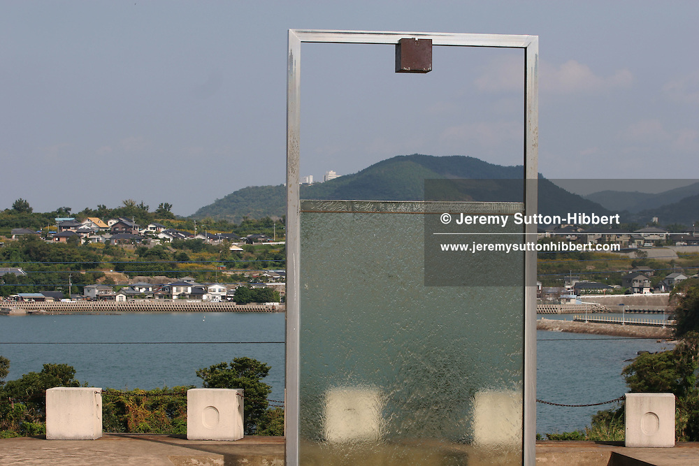 Minamata Memorial, with a box containing the names of those that died, on a hill overlooking the bay, previously infamous as the source of Minamata disease, caused by the 1950's industrial release of methylmercury into Minamata bay, and the subsequent poisoning of residents who ate fish from the bay.