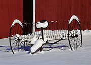 Farm equipment stands silently waiting for winter to pass.