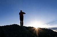 SD00078-00...SOUTH DAKOTA - Hiker on Little Devel's Tower in Custer State Park.