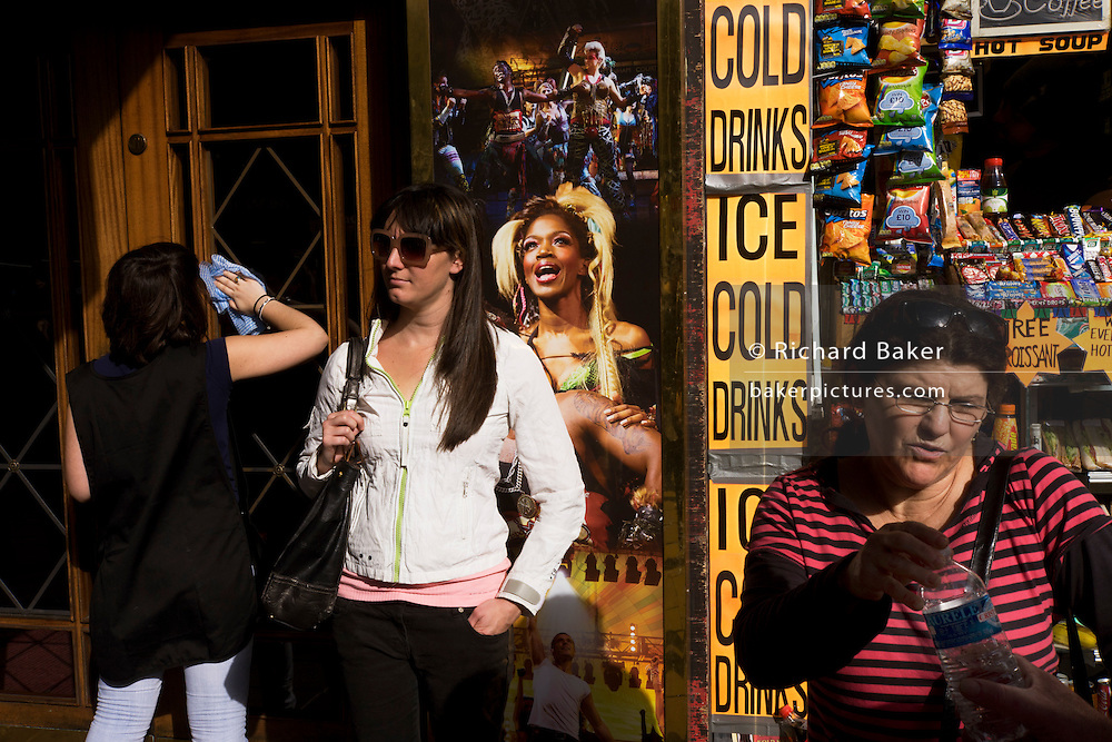 Street scene people outside the Dominion Theatre where the 'We will Rock You' musical is staged, London.