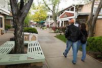 Tourist Couple Walking Through Taos Plaza, Taos, New Mexico