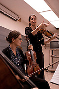 5. Kathryn Lockwood, the viola player for the Lark Quartet, works with Maria Kindt, the viola player in the .graduate string quartet, during a master class at Ohio University in Glidden Hall on Wednesday, October .10th, 2007.