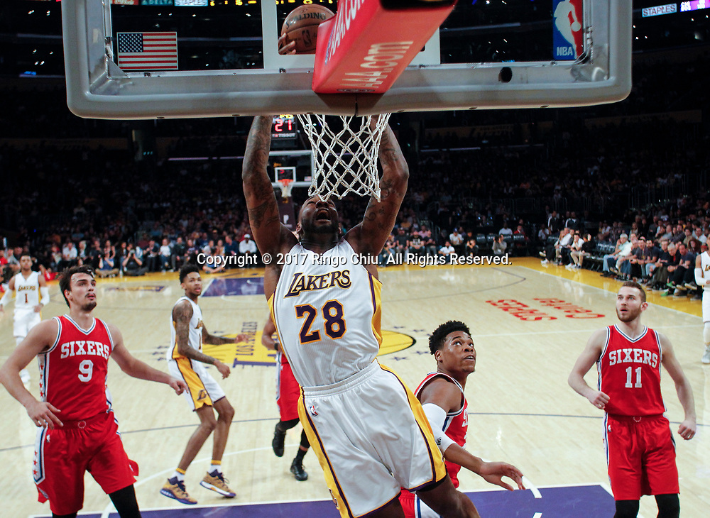 Los Angeles Lakers center Tarik Black (#28) dunks against Philadelphia 76ers during an NBA basketball game Tuesday, March 12, 2017, in Los Angeles. <br /> (Photo by Ringo Chiu/PHOTOFORMULA.com)<br /> <br /> Usage Notes: This content is intended for editorial use only. For other uses, additional clearances may be required.