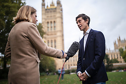 © Licensed to London News Pictures. 04/10/2019. London, UK. Rory Stewart (R) giving an interview in Westminster. Rory Stewart has announced his resignation from the Conservative Party and his intention to stand as an independent candidate for Mayor of London. Photo credit: Rob Pinney/LNP