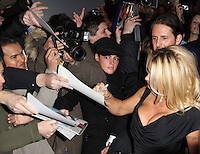 Pamela Anderson arrives for the Premiere of 'The Commuter' held at Aqua, London, UK, 25 October 2010: For piQtured Sales contact: Ian@Piqtured.com +44(0)791 626 2580 (picture by Richard Goldschmidt)