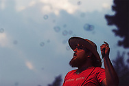 Tim Harrington of the band Les Savy Fav stares at bubbles on stage during his band's set at the Pitchfork/Intonation Music Festival in Chicago's Union Park.