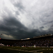 Rain clouds loom over the field during the game at Harvard Stadium on May 10, 2014 in Boston, Massachusetts. (Photo by Elan Kawesch)