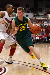 January 27, 2011; Stanford, CA, USA;  Oregon Ducks forward E.J. Singler (25) dribbles past Stanford Cardinal forward/center Josh Owens (13) during the first half at Maples Pavilion.