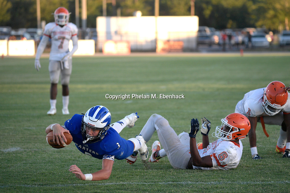 Apopka receiver Jackson Darlington (3) dives for yardage after catching a pass between Orange City University's Tranorris Davis (6) and Mike Williams (1) during the first half of a spring high school football game in Apopka, Fla., Thursday, May 25, 2017. (Photo by Phelan M. Ebenhack)