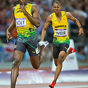 Usain Bolt of Jamaica, left, won the gold medal in the men's 200m final in a time of 19.32 at Olympic Stadium during the 2012 Summer Olympic Games in London, England, Thursday, August 9, 2012. At right is teammate Warren Weir, who finished with the bronze medal. (David Eulitt/Kansas City Star/MCT)