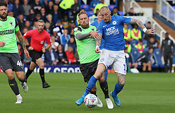 Marcus Maddison of Peterborough United in action with Scott Wagstaff of AFC Wimbledon - Mandatory by-line: Joe Dent/JMP - 28/09/2019 - FOOTBALL - Weston Homes Stadium - Peterborough, England - Peterborough United v AFC Wimbledon - Sky Bet League One