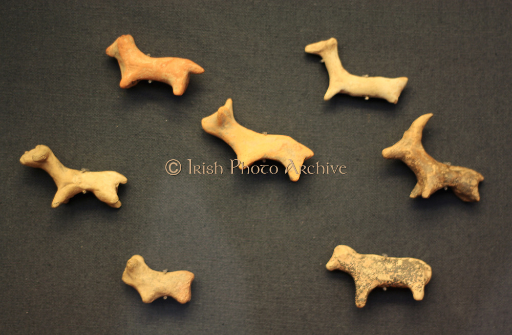Seven terracotta animal figurines. Minoan, 2000-1700 BC. Figurines of cattle, sheep, a dog and a goat.