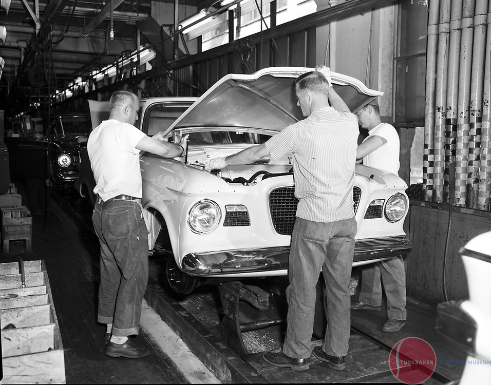 Studebaker workers install a hood on a 1960 Studebaker Lark at the company's South Bend, Indiana, plant.