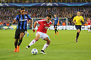 Javier Hernández of Manchester United holds off Jean-Charles Castelleto of Club Brugge during the Champions League Qualifying Play-Off Round match between Club Brugge and Manchester United at the Jan Breydel Stadion, Brugge, Belguim on 26 August 2015. Photo by Phil Duncan.