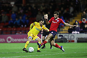 Chester midfielder Craig Mahon (7)  takes on York City midfielder Lewis Hawkins (7)  during the Vanarama National League match between York City and Chester FC at Bootham Crescent, York, England on 13 November 2018.