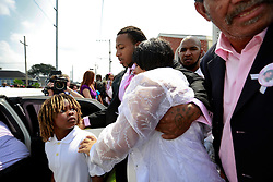 14 September 2013. Prayer Tower Church of God in Christ. New Orleans, Louisiana. <br /> Mourners at the funeral for 11 year old Arabian 'Ray Ray' Gayles, fatally shot September 2nd. Arabian's mother Ashley Moffett, (mid frame). Arabian was cradling a 1 yr old cousin whilst sat on the couch at home when gunmen pulled up outside and sprayed the house with bullets. Arabian was hit in the head and dies shortly afterwards. NOPD is questioning 2 men in connection with the murder.<br /> Photo; Charlie Varley