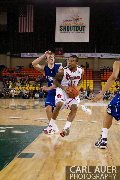 November 26th, 2010:  Anchorage, Alaska - St. John's sophomore guard Malik Stith (31) heads to the lane in the Red Storm's semi final game of the Great Alaska Shootout against the Drake Bulldogs.  The Red Storm defense held Drake to a tournament low score as St. Johns advanced to the final game 82-39.