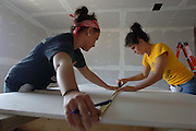 Kent State students measure drywall Wednesday, March 29, 2006 at a home in Biloxi, Miss.<br /> <br /> Photo by Bob Christy/Kent State University<br />  horizontal, biloxi, alternative spring break, student