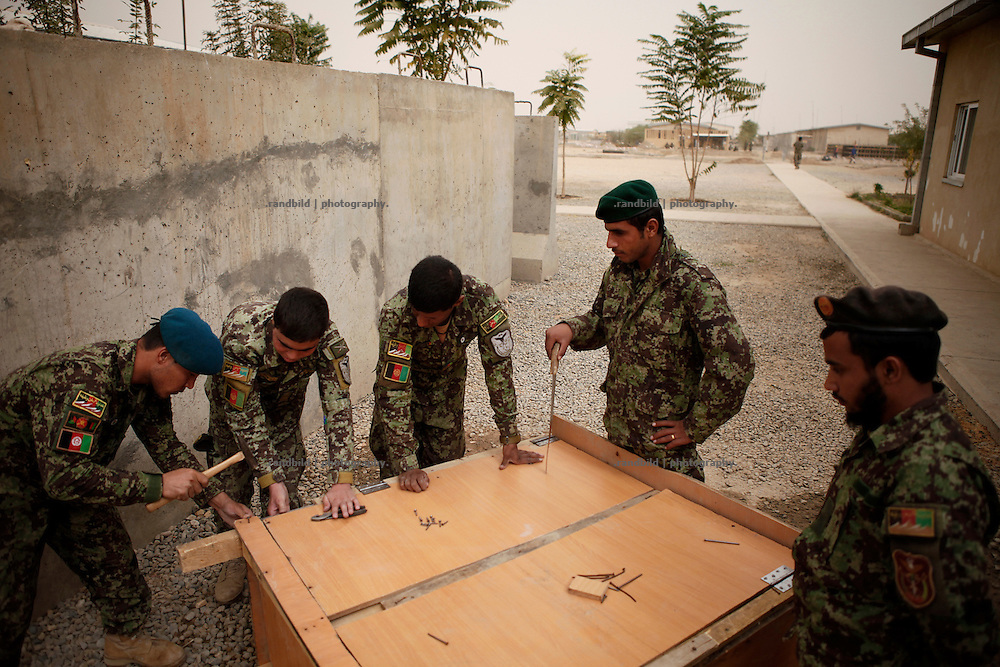 Some afghan Army recruits fix a cupboard to improof their living standart at the Camp Pamir Barracks near Kunduz.