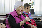 Dec. 29, 2015 - Gwangju, South Korea - Dec 29, 2015 - South Korea, Gwangju : <br /> <br /> South Korea, Japan Reach Agreement On 'Comfort Women'<br /> <br /> Former South Korean World War II sex slave womens, who was forced to serve for the Japanese Army during World War II, sits after a meeting with a South Korean Foreign Ministry official at the House of Sharing, the home for the living sex slaves, in Gwangju, South Korea. A day after trumpeting an ''irreversible'' settlement of a decades-long standoff over Korean women forced into sexual slavery by Japan's WWII military, there's relief among South Korean and Japanese diplomats, fury among activists and many of the elderly victims and general public indifference in both countries.<br /> ©Exclusivepix Media