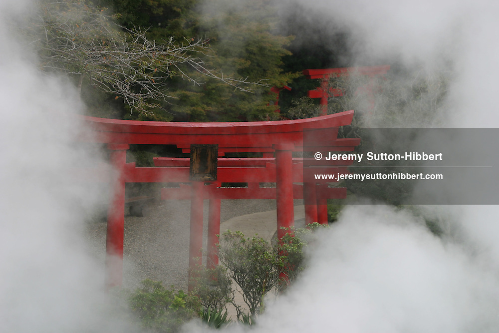 The red 'Torii' gates of a shinto shrine, stand beside a volcanic water source known as 'Umi Jogoku' (Sea-Hell), in Beppu town, Japan. 20.10.2005