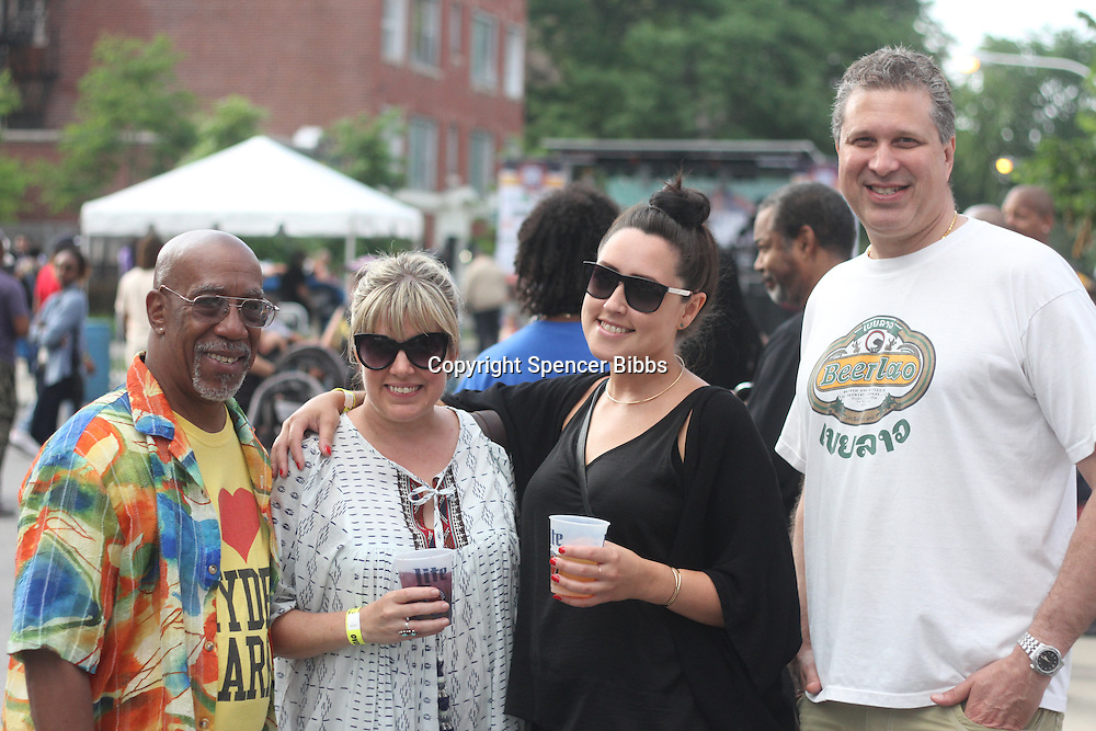 "Hyde Park held its 4th annual Brew Fest celebration this past weekend in Harper Court located at 53rd and Harper. There was live music, food, arts and crafts and a beer tasting from many breweries around the city.<br /> <br /> 0001 – Executive Director for the Hyde Park Chamber of Commerce, Wallace Goode, Owner of Modern Cooperative, Tiffany Paige, Manger at Modern Cooperative, Megan Fox and Arnold Toole of Toole Law Offices<br /> <br /> Please 'Like' ""Spencer Bibbs Photography"" on Facebook.<br /> <br /> All rights to this photo are owned by Spencer Bibbs of Spencer Bibbs Photography and may only be used in any way shape or form, whole or in part with written permission by the owner of the photo, Spencer Bibbs.<br /> <br /> For all of your photography needs, please contact Spencer Bibbs at 773-895-4744. I can also be reached in the following ways:<br /> <br /> Website – www.spbdigitalconcepts.photoshelter.com<br /> <br /> Text - Text ""Spencer Bibbs"" to 72727<br /> <br /> Email – spencerbibbsphotography@yahoo.com"