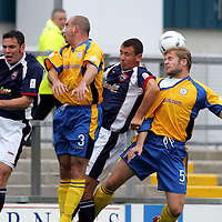 Ross County v St Johnstone.....11.09.04<br />Kevin Rutkiewicz gets his head to the ball, beating ex St Johnstone player John Robertson<br /><br />Picture by Graeme Hart.<br />Copyright Perthshire Picture Agency<br />Tel: 01738 623350  Mobile: 07990 594431