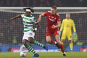 A bandaged Dedryck Boyata is pursued by Sam Cosgrove during the Betfred Cup Final between Celtic and Aberdeen at Hampden Park, Glasgow, United Kingdom on 2 December 2018.