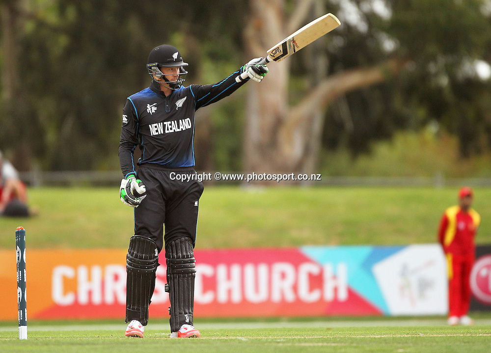 Martin Guptill of the Black Caps raises his bat after reaching 50 runs during the ICC Cricket World Cup warm up game between the Black Caps v Zimbabwe at Bert Sutcjliffe Oval, Lincoln, Christchurch. 9 February 2015 Photo: Joseph Johnson / www.photosport.co.nz