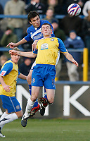 Photo: Steve Bond/Sportsbeat Images.<br /> Macclesfield Town v Hereford United. Coca Cola League 2. 26/12/2007. Martin Gritton (higher) gets a header in above Lee Collins