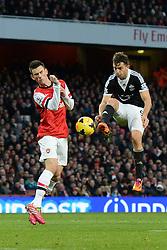 Arsenal's Laurent Koscielny reacts as Southampton's Jay Rodriguez takes a shot at goal - Photo mandatory by-line: Mitchell Gunn/JMP - Tel: Mobile: 07966 386802 23/11/2013 - SPORT - Football - London - Emirates Stadium - Arsenal v Southampton - Barclays Premier League