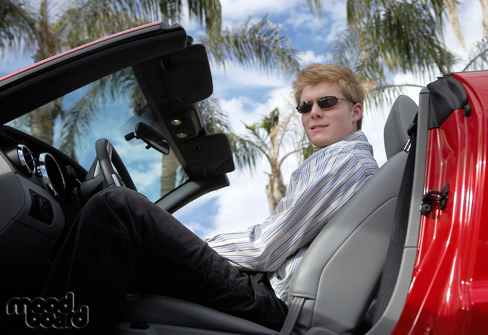 Teenager in Sports Car Convertible