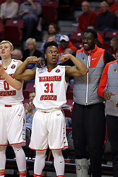 "26 November 2016:  Bench celebration includes Isaac Gassman(0), Javaka Thompson(31), and Daouda ""David"" Ndiaye (4) during an NCAA  mens basketball game between the IUPUI Jaguars the Illinois State Redbirds in a non-conference game at Redbird Arena, Normal IL"